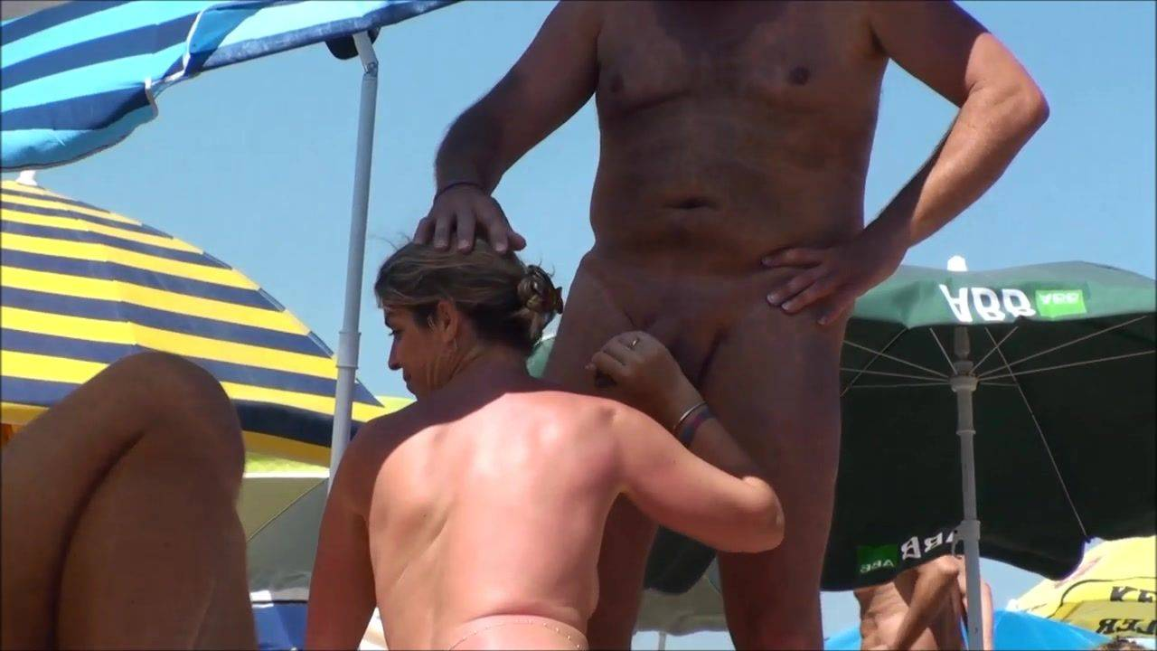 Nude black lick dick on beach
